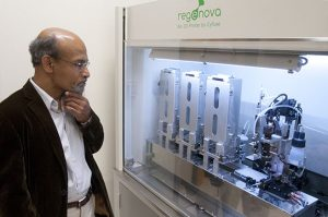 Dr. Nalim looks at the Regenova 3D bioprinting technology