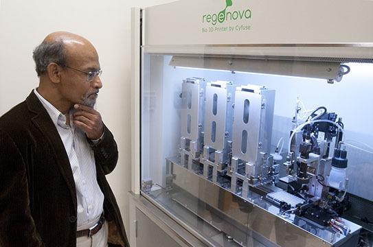 Dr. Nalim looks at the Regenova 3D bioprinting technology